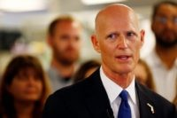 Florida Gov. Rick Scott speaks at NeoGenomics Laboratories, a cancer research company, in Fort Myers, Fla., on Monday, May 11, 2015. Scott came to talk about job growth, award Chairman and CEO Douglas VanOort with the Governor's Business Ambassador Award, and highlight a Naples-raised resident and technician with the company, …
