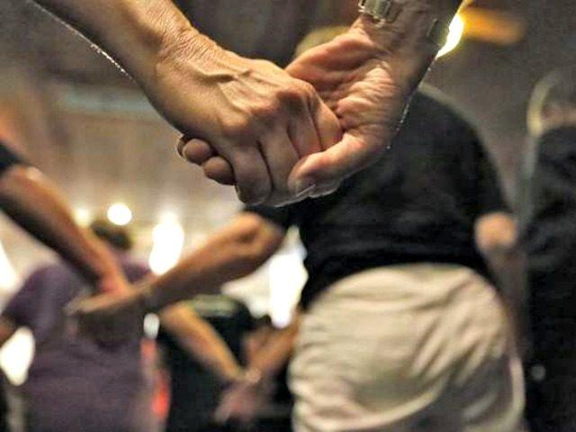 Holding Hands After Orlando Terror AP Pablo Martinez Monsivais