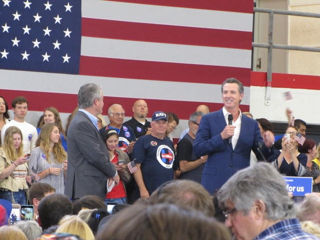 Gavin Newsom at Clinton rally (Michelle Moons / Breitbart News)