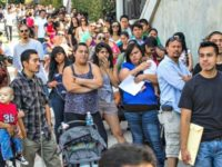 Immigrants line up for delayed deport and work permits.