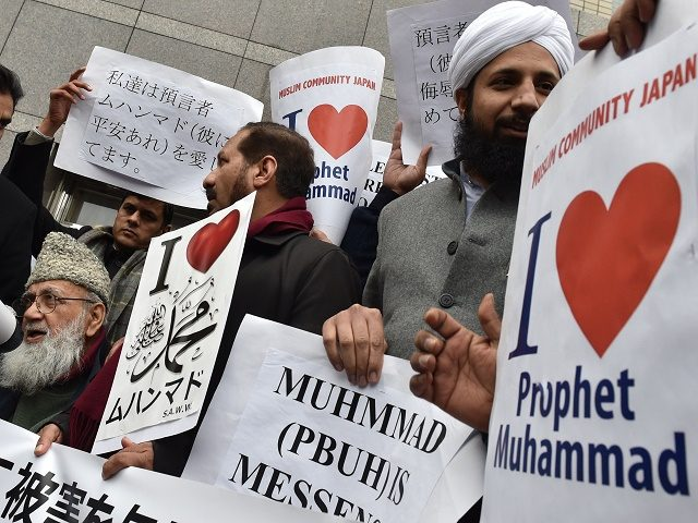 Muslims living in Japan stage a demonstration near the offices of Japanese publishing company Dai-san Shokan in Tokyo on February 13, 2015. Dai-san Shokan, a small Japanese publisher, on February 10 issued 3,000 copies of a book of cartoons by French satirical magazine Charlie Hebdo, including controversial drawings of Mohammed. …