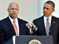 Jeh-Johnson-L-with-Obama-Charles-DharapakAP