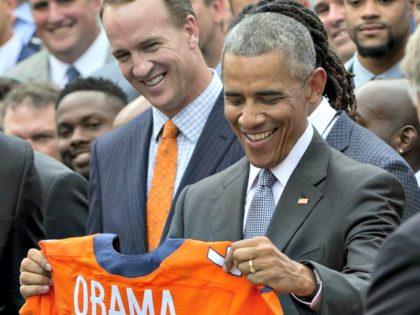 Obama and Peyton Manning AP