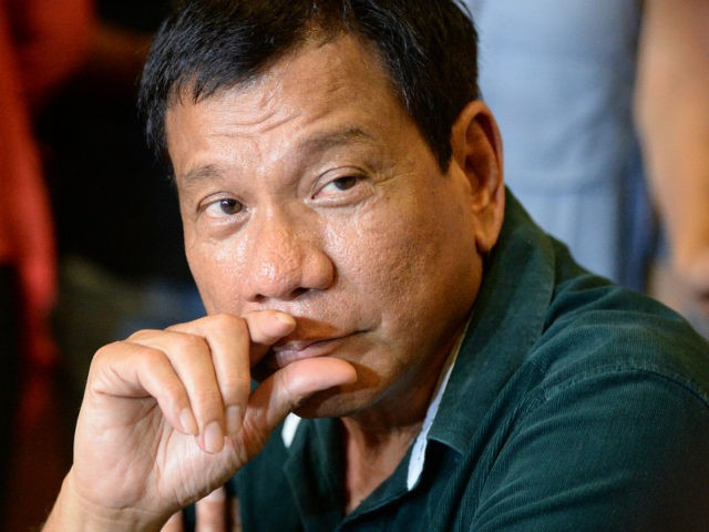"PHILIPPINES, DAVAO : Philippine President-elect Rodrigo Duterte speaks during his first press conference since he claimed victory in the presidential election, at a restaurant in Davao City, on the southern island of Mindanao on May 15, 2016. Duterte vowed on May 15 to reintroduce capital punishment and give security forces ""shoot-to-kill"" orders in a devastating war on crime. / AFP PHOTO / TED ALJIBE"