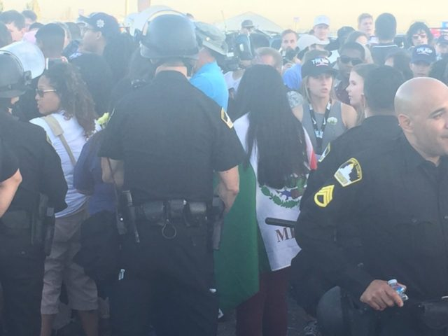 Protester wearing flag with Mexico written on it (Michelle Moons / Breitbart News)