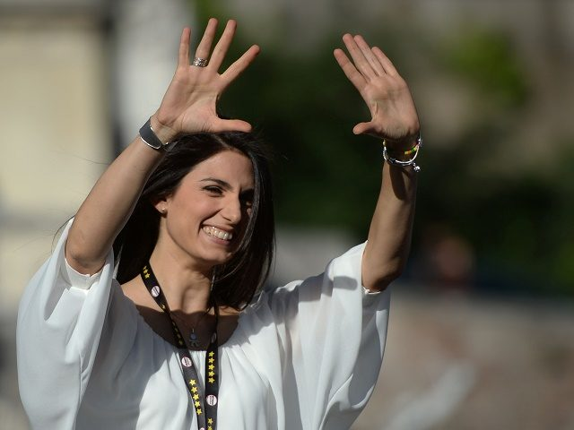 Italian Virginia Raggi, Five Star Movement (M5S) candidate for the election of Rome's mayor attends a campaign meeting on June 3, 2016 at Piazza del Popolo in Rome. The first round of the Municipal elections will be held on June 5. / AFP / Filippo MONTEFORTE (Photo credit should read …