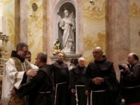 The newly elected Custodian of the Holy Land Friar Francesco Patton is greeted by fellow friars during his official entry ceremony on June 6, 2016 at the Franciscan Church of Saint Savior Monastery in Jerusalem's Old City