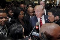 Presidential candidate Donald Trump speaks to the media after meeting with a group of black pastors at his office in the Manhattan borough of New York November 30, 2015. REUTERS/Lucas Jackson - RTX1WKPT