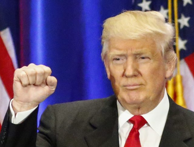 Trump fist (Kena Betancur / AFP / Getty)