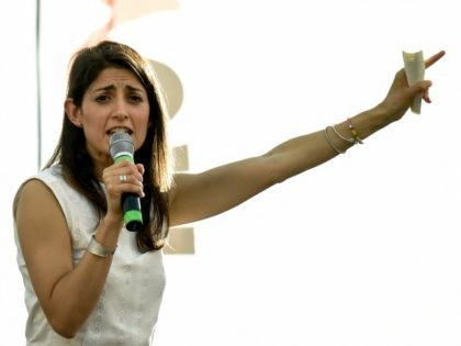 Virginia Raggi, Five Star Movement (M5S) candidate for the mayoral elections in Rome, speaks during her last campaign meeting on June 17, 2016 at Ostia Lido, Rome's seashore, before the second round of the election.