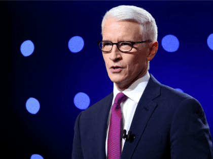 Debate moderator Anderson Cooper looks during the CNN Democratic Presidential Primary Debate between Democratic presidential candidate Hillary Clinton and candidate Senator Bernie Sanders (D-VT) at the Whiting Auditorium at the Cultural Center Campus on March 6, 2016 in Flint, Michigan.