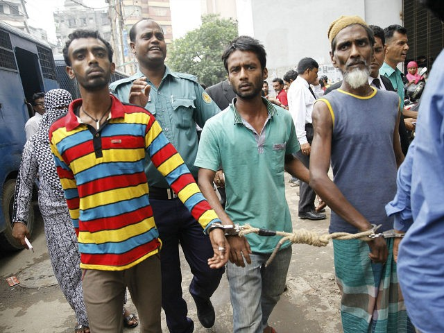 BANGLADESH, Dhaka : Bangladeshi police escort arrested men in Dhaka on June 12, 2016, who were detained during a anti-militant crackdown across the country . Around 5,000 people, including suspected ordinary criminals with existing warrants against them, have been arrested after police launched a controversial anti-militant drive across the Muslim-majority …