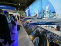 Various scale models of Boeing commercial aircraft are seen on display during the Singapore Airshow at the Changi exhibition centre in Singapore on February 16, 2016.