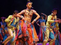 Indian dancers perform on May 19, 2008 during 'The Merchants of Bollywood', a dance play based on a true life story, presented at the Theatre of Dance at Durban's International Convention Centre in Durban. Featuring a cast of 40 singers and dancers is set in songs and music from Bollywood films, the world's largest film industry. The dance theatrical has performed in Germany, Australia, the United Kingdom and other countries worldwide. AFP PHOTO/RAJESH JANTILAL (Photo credit should read RAJESH JANTILAL/AFP/Getty Images)
