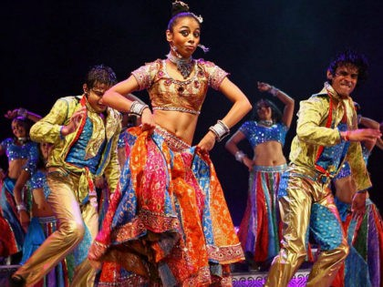 Indian dancers perform on May 19, 2008 during 'The Merchants of Bollywood', a dance play based on a true life story, presented at the Theatre of Dance at Durban's International Convention Centre in Durban. Featuring a cast of 40 singers and dancers is set in songs and music from Bollywood …