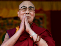 The Dalai Lama takes to the stage to address the faithful in Aldershot on June 29, 2015 which has a large Nepalese Buddhist community made up mainly of serving and retired Gurkha soldiers. AFP PHOTO / BEN STANSALL (Photo credit should read BEN STANSALL/AFP/Getty Images)