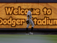 A sign welcomes fans to Dodger Stadium as the Los Angeles Dodgers host the Houston Astros on August 26, 2005 at Dodger Stadium in Los Angeles, California. The Astros went on to win 2-1. (Photo by Stephen Dunn /Getty Images)
