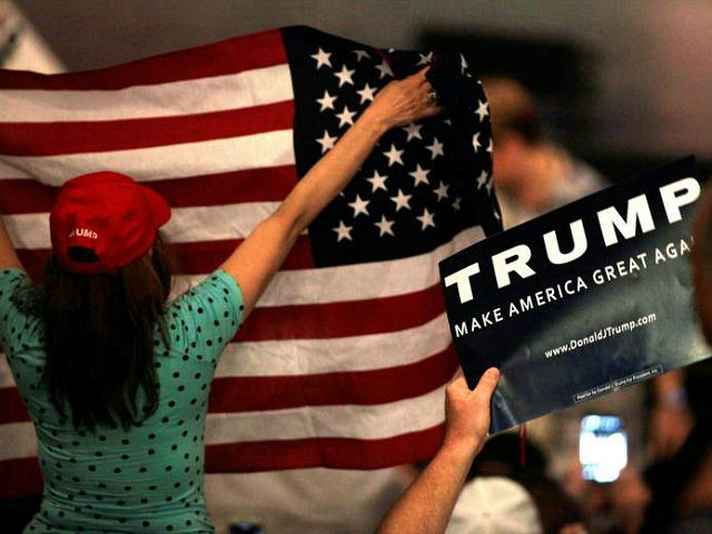 Supporters cheer as they wait for US Republican presidential candidate Donald Trump to speak at a rally at the Treasure Island Hotel in Las Vegas on June, 18, 2016. / AFP / John GURZINSKI (Photo credit should read JOHN GURZINSKI/AFP/Getty Images)