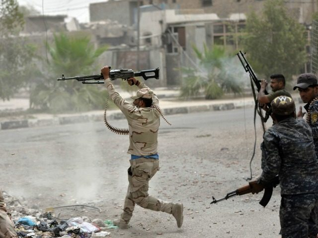 Iraqi government forces clash with Islamic State (IS) group fighters in Fallujah on June 18, 2016 as they hunt down holdout jihadists after retaking the city which was IS's last remaining major hub in Iraq.
