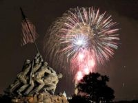 The United States Marine Corps War Memorial, better known as the Iwo Jima Memorial, is seen in Arlington, Va., Monday July 4, 2011, as fireworks burst over Wasington, during the annual Fourth of July display. (AP Photo/Carolyn Kaster)