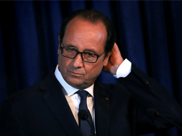 French President Francois Hollande looks on during a joint press conference with Iraqi Kurdish leader Massud Barzani in Arbil, the capital of the Kurdish autonomous region in northern Iraq, on September 12, 2014.
