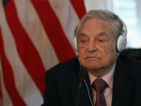 Billionaire George Soros litens to remarks by Commerce Secretary Penny Pritzker and Tunisian President Beji Caid Essebsi during a roundtable discussion with a group of American business leaders, at the Blair House May 20, 2015 in Washington, DC.
