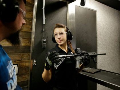 Shayna Zerbe instructs Garret Sloan, left, on how to fire a fully automatic machine gun at Machine Guns Vegas Thursday, Aug. 28, 2014, in Las Vegas. Most visitors to Machine Guns Vegas have already pulled the trigger on an Uzi or an M5, from the behind the controls of their …