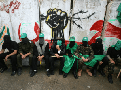 Palestinian Hamas supporters attend the funeral of militants killed during fire exchange against Israeli forces the previous day in the central Gaza Strip refugee camp of Maghazi, 21 December 2007.