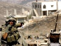 In this photo released by the Israel Defense Forces (IDF), Israeli troops operate against Hezbollah militants July 29, 2006 in the south Lebanese village of Marun al-Ras. The Israeli Government refused a UN request July 29 for a 72 hour truce in Southern Lebanon for humanitarian efforts, citing a corridor opened in the area for aid. (Photo by Abir Sultan/IDF via Getty Images)