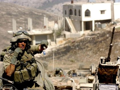 In this photo released by the Israel Defense Forces (IDF), Israeli troops operate against Hezbollah militants July 29, 2006 in the south Lebanese village of Marun al-Ras. The Israeli Government refused a UN request July 29 for a 72 hour truce in Southern Lebanon for humanitarian efforts, citing a corridor …