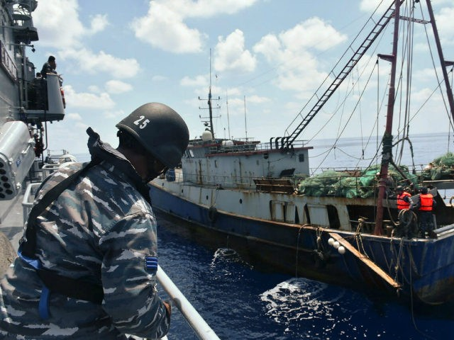 "INDONESIA : This handout photo released by the Indonesian Navy and available on June 21, 2016 shows Indonesian War Ship KRI Imam Bonjol-363 (L) arresting a Chinese fishing boat (R) in Natuna water. Indonesia's navy said on June 21 that poaching by Chinese trawlers in its waters was a ""ruse"" to stake Beijing's claim to fishing grounds, after the latest clash in the South China Sea. RESTRICTED TO EDITORIAL USE - MANDATORY CREDIT ""AFP PHOTO / INDONESIAN NAVY"" - NO MARKETING NO ADVERTISING CAMPAIGNS - DISTRIBUTED AS A SERVICE TO CLIENTS / AFP PHOTO / INDONESIA NAVY / HANDOUT / RESTRICTED TO EDITORIAL USE - MANDATORY CREDIT ""AFP PHOTO / INDONESIAN NAVY"" - NO MARKETING - NO ADVERTISING CAMPAIGNS - DISTRIBUTED AS A SERVICE TO CLIENTS"
