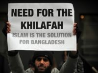A Muslim protester holds a pro-Islamic rule sign during a protest outside the embassy of Bangladesh in central London on March 1, 2013, a day after the vice president of Jamaat-e-Islami party was found guilty of murder, religious persecution and rape by a war crimes tribunal in Bangladesh