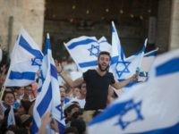 Israelis dance with flags during a march marking Jerusalem Day on May 17, 2015 outside Jerusalem's old city, Israel. Israel is celebrating the anniversary of the 'unification' of Jerusalem, marking 48 years since it captured mainly Arab east Jerusalem during the 1967 Middle East war. (Photo by Lior Mizrahi/Getty Images)