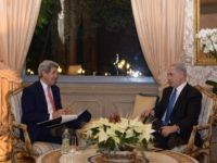 In this handout provided by the Israeli Government Press Office, Israel Prime Minister Benjamin Netanyahu (R) talks with U.S. Secretary of State John Kerry as they meet December 15, 2014 in Rome, Italy.