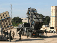 Israeli soldiers walk near an Israeli Irone Dome defence system (L), a surface-to-air missile (SAM) system, the MIM-104 Patriot (C), and an anti-ballistic missile the Arrow 3 (R) during Juniper Cobra's joint exercise press briefing at Hatzor Israeli Air Force Base in central Israel, on February 25, 2016.