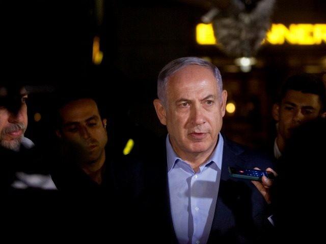 Israeli Prime Minister Benjamin Netanyahu speaks to the press at the scene of a shooting outside Max Brenner restaurant in Sarona Market on June 8, 2016 in Tel Aviv, Israel.