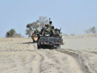 Niger, Bosso : A file picture taken on May 25, 2015 shows Nigerien soldiers patroling near Bosso, Niger. The first of an expected 2,000 troops from regional military powerhouse Chad began arriving in neighbouring Niger on June 8, 2016, where Boko Haram insurgents inflicted heavy losses in the town of …