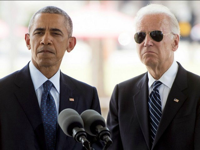 US President Barack Obama speaks alongside Vice President Joe Biden after placing flowers for the victims of the mass shooting at a gay nightclub Sunday at a memorial at the Dr. Phillips Center for the Performing Arts in Orlando, Florida, June 16, 2016. / AFP / SAUL LOEB (Photo credit …