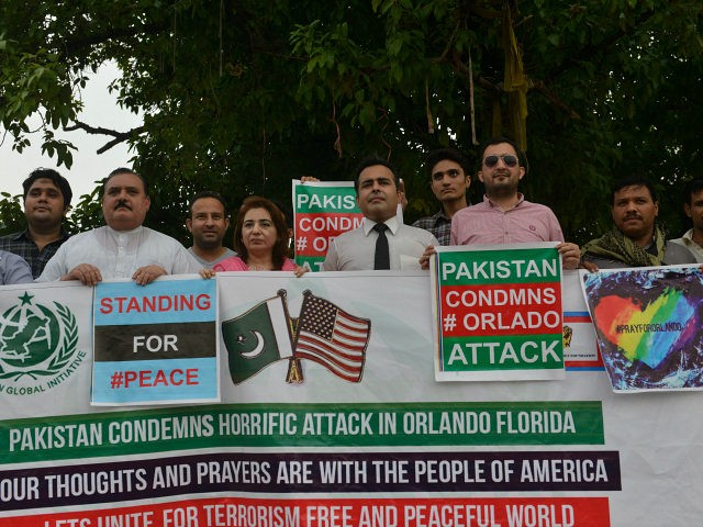 Pakistani civil society activists carry placards during a vigil for the victims of the Orlando shooting in Florida, in Lahore on June 14, 2016. The assault, which left 50 people dead including the shooter, is the worst mass shooting in modern US history, and has triggered an outpouring of grief …