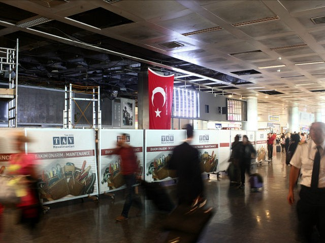 ISTANBUL, TURKEY - JUNE 29: Passengers walk in the damaged parts of the international terminal of the country's largest airport, Istanbul Ataturk, following yesterday's blast on June 29, 2016 in Istanbul, Turkey. Three suicide bombers opened fire before blowing themselves up at the entrance to the main international airport in …