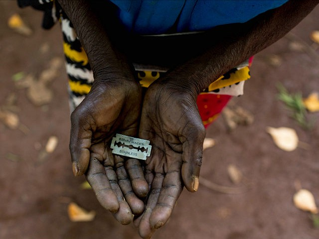 *** EXCLUSIVE *** MOMBASA, KENYA - JUNE 25: Cutter Anna-Moora Ndege shows the razorblade she uses to cut girls' genitals , on June 25, 2015, in Mombasa, Kenya. THESE are the rudimentary tools used to cut young girls sexual organs in remote villages in Kenya. The cruel practice of female genital mutilation (FGM) is illegal in the UK and in dozens of countries in Africa. But in remote Kenyan villages and communities far from the capital, Nairobi, the practice is very much alive and well. PHOTOGRAPH BY Ivan Lieman / Barcroft Media (Photo credit should read Ivan Lieman / Barcroft Media via Getty Images)