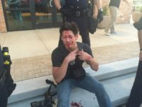 reporter bloodied by rock thrown at Trump event in Dallas, June 16, 2016.