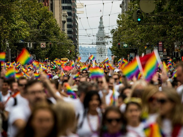 SAN FRANCISCO, CA- JUNE 28: San Francisco's Ferry Builiding is seen behind marchers in the San Francisco Gay Pride Parade, June 28, 2015 in San Francisco, California. The 2015 pride parade comes two days after the U.S. Supreme Court's landmark decision to legalize same-sex marriage in all 50 states. (Photo …