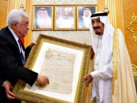 Mahmoud Abbas handing Saudi King Salmon a copy of Zionist newspaper
