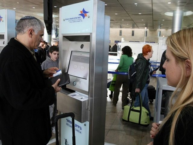 Passengers check-in using a new security machine as part of measures to increase security at Israel's Ben-Gurion International Airport near Tel Aviv on January 05, 2010.