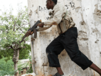 A fighter belonging to the Al-Shabab militias runs with his weapon during clashes with Somali government troops in the streets of Somalia's capital, Mogadishu on May 22, 2009.