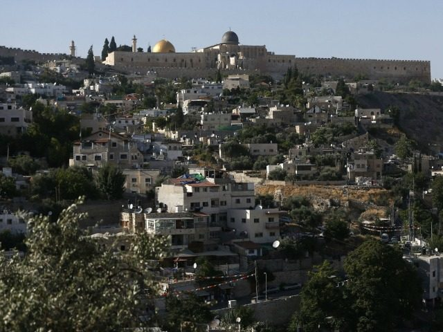 A general view of Silwan, a neighbourhood in Palestinian-dominated east Jerusalem next to the historic Old City (background), on June 15, 2016.