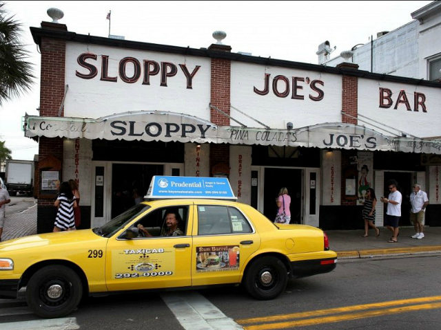 KEY WEST, FL - SEPTEMBER 12: A taxi drives past Sloppy Joe's Bar on Duval Street on September 12, 2013 in Key West, Florida. The city recently enacted a Key West City Ordinance that will allow taxi cab drivers to charge $50 over the price of the cab ride to …