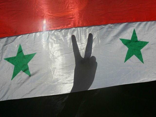 alestinian youths flash V-signs while they hold Syrian flags during a pro-Syrian demonstration November 18, 2005 in Gaza City, Gaza Strip.