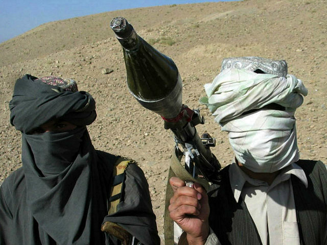 "Face-covered militants who they say are Talibans pose with an RPG in Zabul province, southern of Kabul, Afghanistan Saturday, Oct. 7, 2006. A Taliban commander said in a sit-down interview that insurgent fighters will battle ""Christian"" troops until they leave Afghanistan and a fundamentalist government is established in Kabul, warning …"